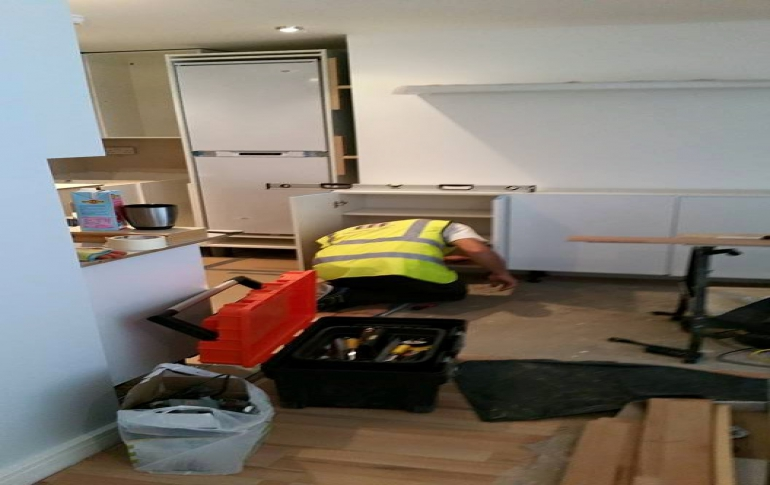 Camberwell-Grove-flat-reconfiguration-fitting-new-kitchen-cabinets.jpg